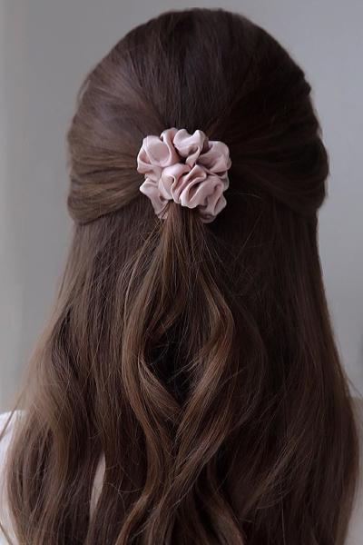 half up hairstyle with silk scrunchie