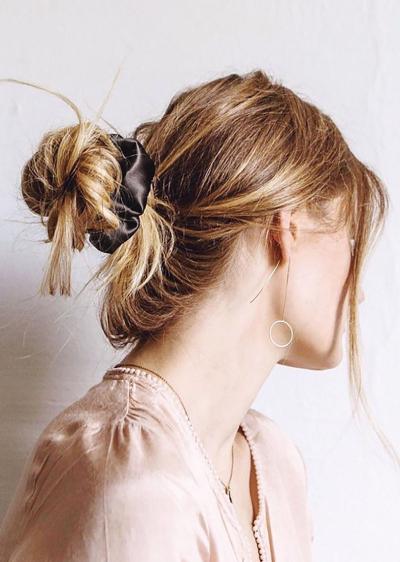 sloppy styling with silk scrunchie